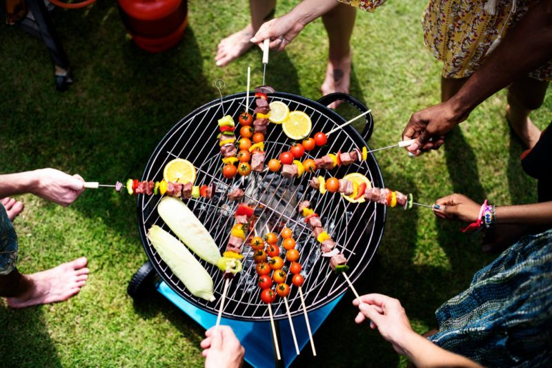 Aerial View Of A Diverse Group Of Friends Grilling Barbecue Outdoors