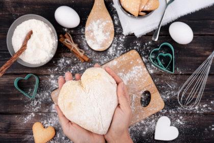 Hands Holding Heart Shaped Dough